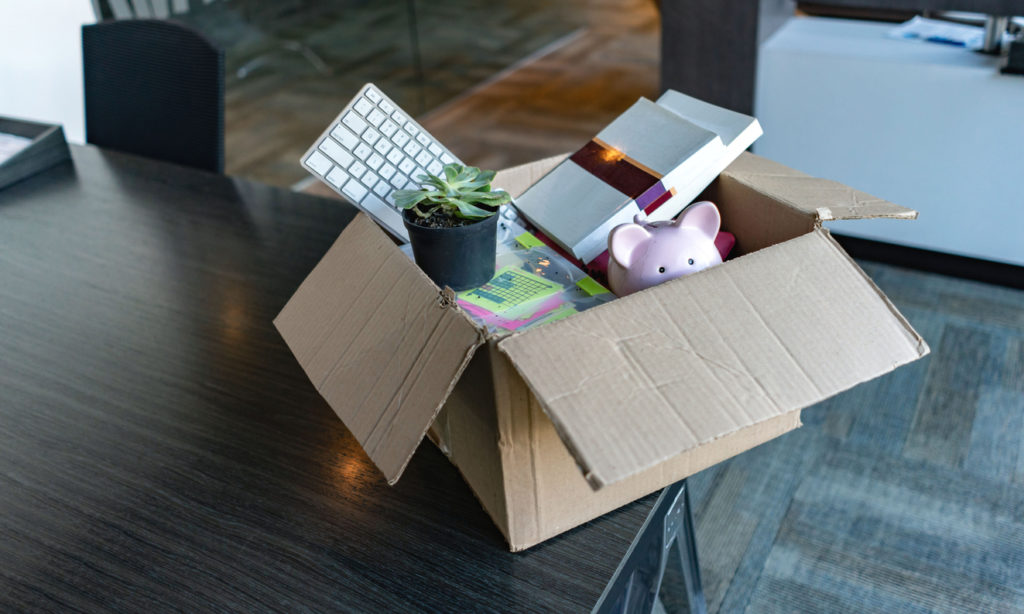 Moving office and packing belongings in a box