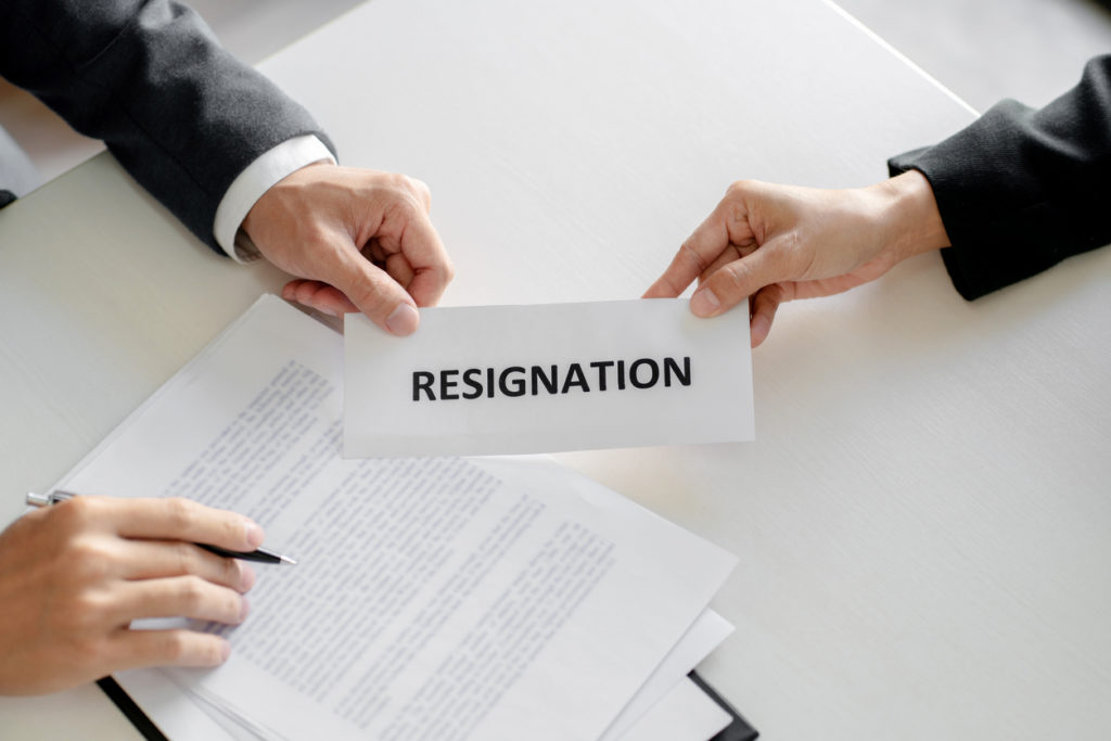 Business people giving a resignation letter to manager.