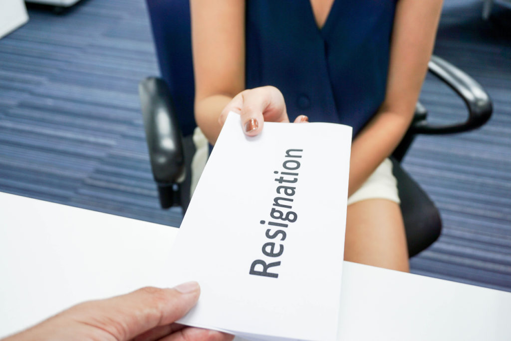 woman submit a resignation letter to her boss